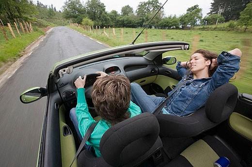 Stock Photo: 1436R-274742 Friends in convertible car, Gipuzkoa, Euskadi. Spain.