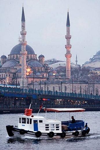 Stock Photo: 1436R-278814 Galata bridge, Yeni mosque and ferry boat on the Bosphore at sunset, Istanbul. Turkey