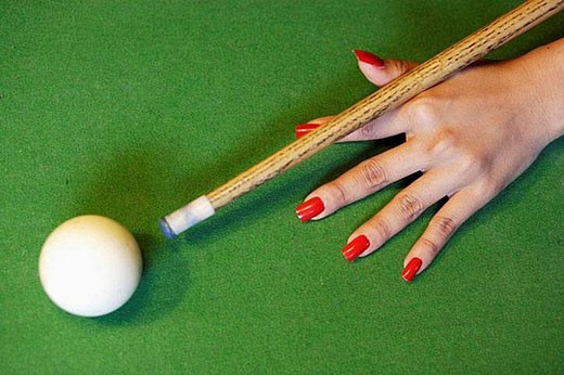 Female hand with red nails holding the queue and targeting the white ball at a snooker game, Bangkok, Thailand, Southeast Asia : Stock Photo