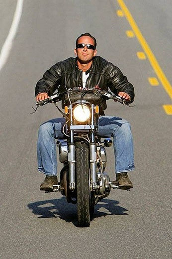Stock Photo: 1436R-280415 Man riding his Harley Davidson Motorcycle