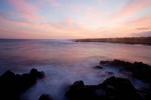 Dusk settles over the Pacific Ocean in this time exposure of South Point on the Big Island of Hawaii, Hawaii, USA. South Point is the southern most point of the United States. : Stock Photo