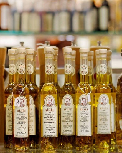 Olive oil bottles on display, Central Market, Florence, Italy : Stock Photo