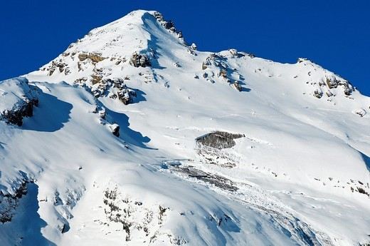 Wind-slab spots on the south face of peak Dent Favre, Ovronnaz, Valais, Switzerland : Stock Photo