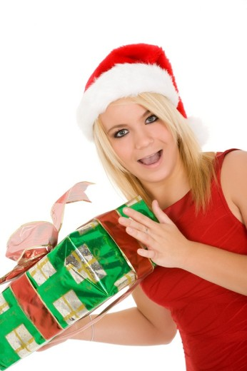 Stock Photo: 1436R-300003 Beautiful Caucasain female holding gifts on white background