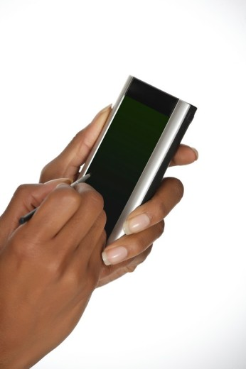 Stock Photo: 1436R-300068 Close up of an African American woman holding a PDA