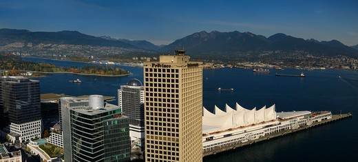 Aerial view of Burrard Inlet with North and West Vancouver from downtown and coastal mountain range : Stock Photo
