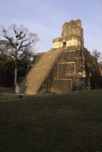 Stock Photo: 1436R-301497 Sunrise over Mayan ruins of Temple I, Temple of the Grand Jaguar, in the Great Plaza of UNESCO World Heritage site of Tikal- Tikal National Park, Guatemala