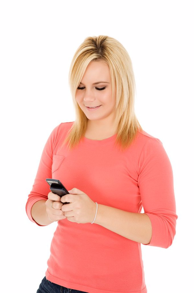 Stock Photo: 1436R-302029 Beautiful Caucasian woman text messaging on white background