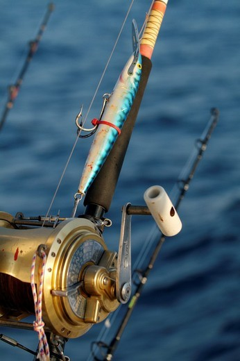 Stock Photo: 1436R-303025 France mediterranean sea rod and reel on board of a game fishing boat in the morning
