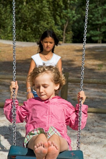 Stock Photo: 1436R-303618 Children swinging
