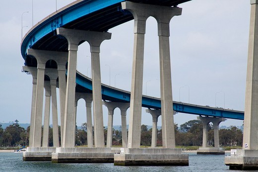 Stock Photo: 1436R-303915 Mission-arched shaped concrete towers resting on prestressed reinforced concrete piles that support the curved Coronado Bridge in San Diego in California