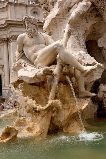 Stock Photo: 1436R-304584 Fountain of the Four Rivers by Bellinio, designed to carry the Egyptian obalisque brough from the Circus Maximus  The 4 figures represent the Nile, Ganges, Danube amd Rio de la plata  Plazza Novona, Rome