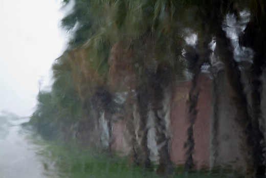 Heavy rain falling on a car windscreen during a rainstorm in Cuba. : Stock Photo
