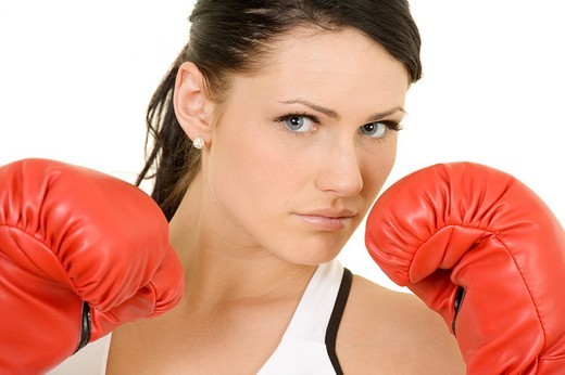 Beautiful Caucasian woman working out with boxing gloves : Stock Photo