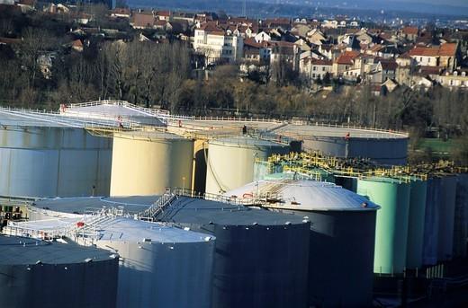 France paris suburbs nanterre oil tanks near a small detached houses area : Stock Photo
