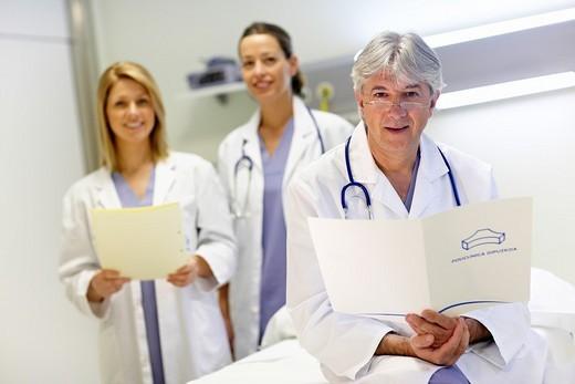 Stock Photo: 1436R-307143 Doctor and nurses in a hospital room. Hospital Policlinica Gipuzkoa, San Sebastian, Donostia, Euskadi, Spain