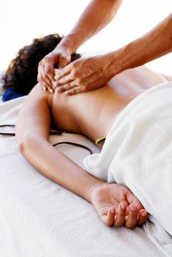 Stock Photo: 1436R-308044 A man practicing a deep tissue massage on a woman's back