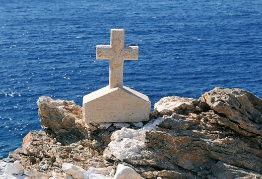 small cross in front of the sea : Stock Photo