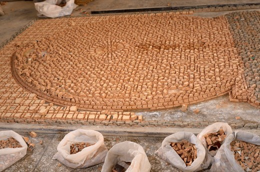 Upside down pieces of Zellige terra cotta glazed tiles to form a mosaic pattern Fes Morocco : Stock Photo