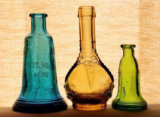 Three small antique bottles : Stock Photo