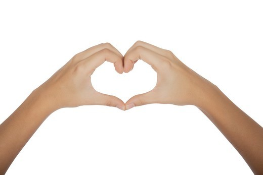 Female hands forming a heart on white background with clipping path : Stock Photo