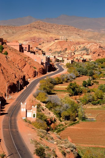 Farmland and red rock hills along road in Dades Gorge in the High Atlas mountains Morocco : Stock Photo