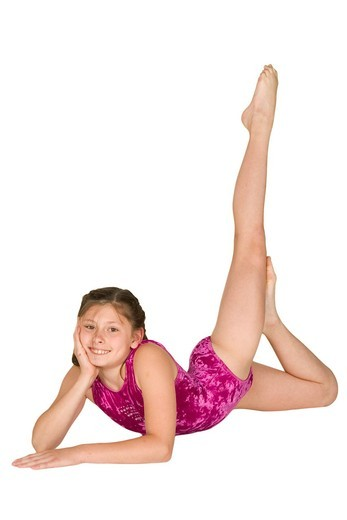 Stock Photo: 1436R-312297 Ten year old caucasian girl in gymnastics poses