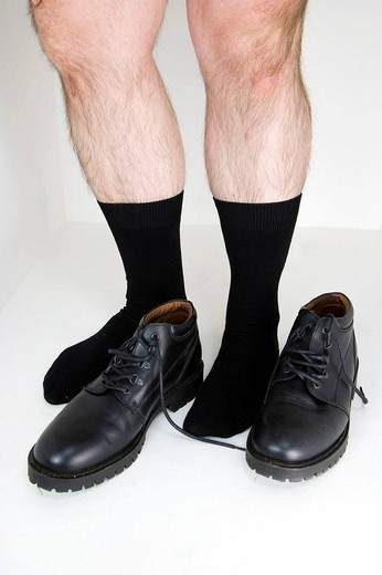 Man´s legs and black shoes. : Stock Photo