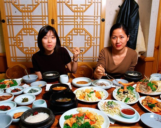 Stock Photo: 1436R-318560 Two women eating Korean food