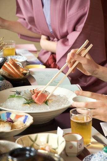 Two young women eating dinner in Japanese style inn, close_up : Stock Photo