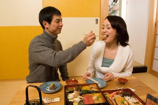 Couple having New Years Day meal : Stock Photo