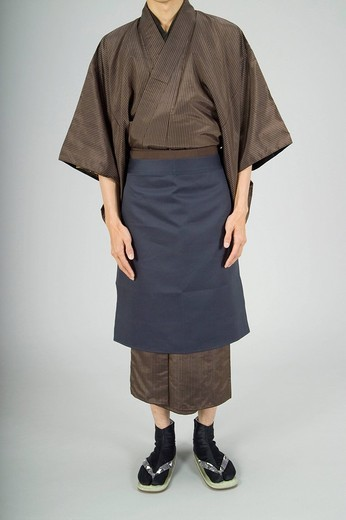Stock Photo: 1436R-324180 Man wearing kimono with apron