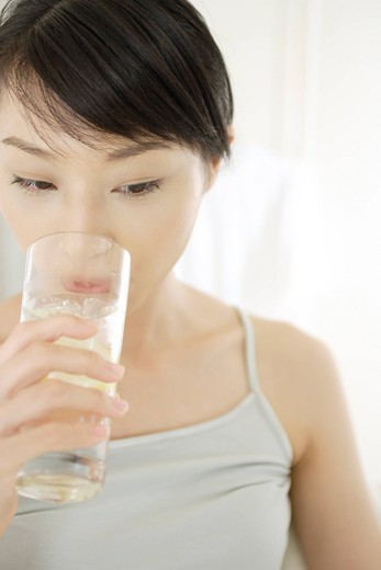 A young woman drinking : Stock Photo