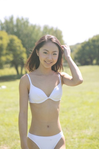 Portrait of a young woman in bikini : Stock Photo