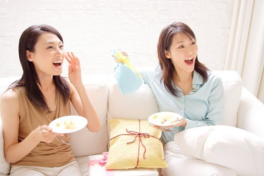 Two young women enjoying party at home : Stock Photo