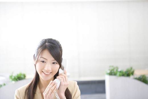 Young woman talking on phone : Stock Photo