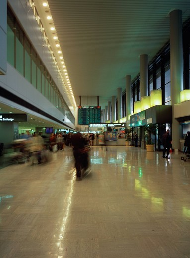 Busy airport terminal, blurred motion : Stock Photo