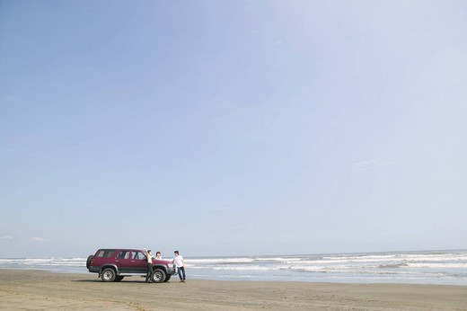 Car parked on beach : Stock Photo