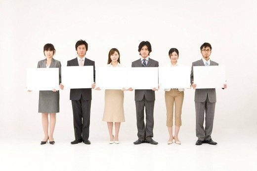 Business people holding blank placards : Stock Photo