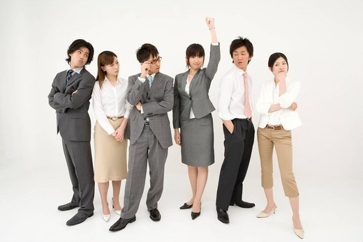 Businesswoman standing out from the group : Stock Photo