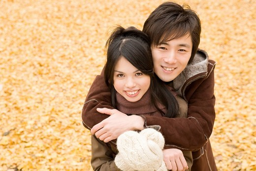 Young couple looking at camera : Stock Photo