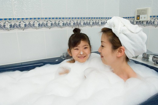 Mother and daughter taking bath : Stock Photo