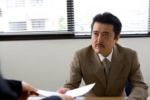 Businessman receiving document : Stock Photo