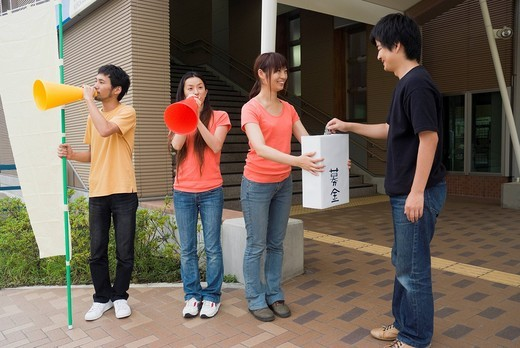 Young people asking donation : Stock Photo
