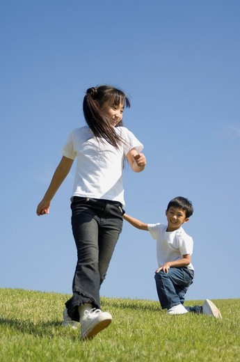Stock Photo: 1436R-333725 Children playing in field