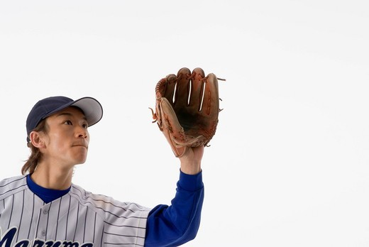 Stock Photo: 1436R-333803 Baseball player trying to catch a ball