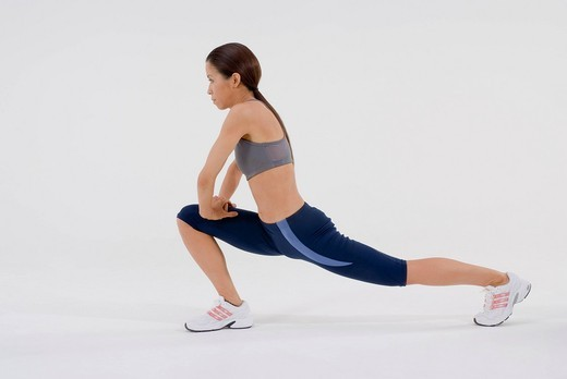 Stock Photo: 1436R-333852 Female runner stretching