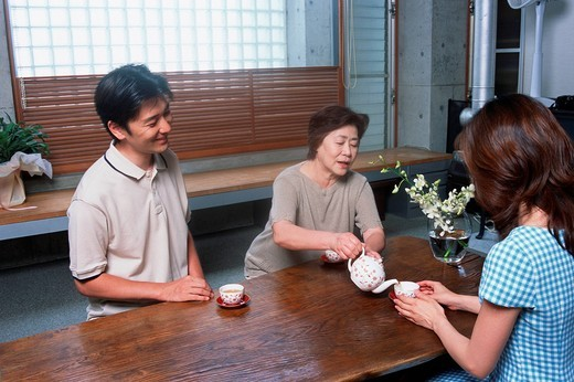 A senior woman serving tea : Stock Photo