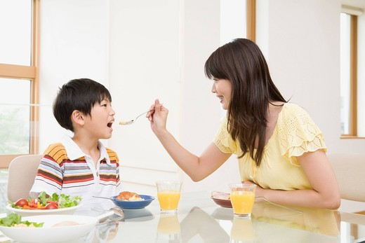 Family eating breakfast : Stock Photo