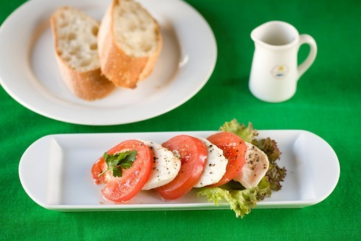 Insalata di caprese and bread : Stock Photo